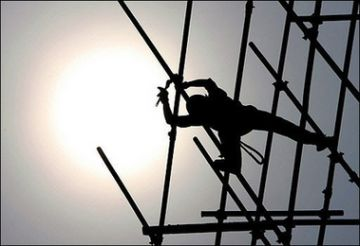 a chinese worker builds scaffolding for commercial