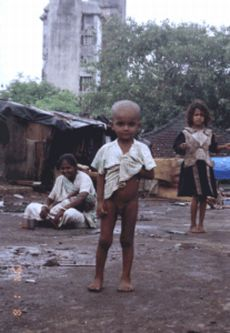 child in unhygienic slum