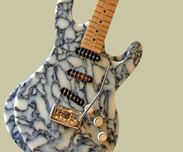 5 creative guitars made from recycled materials green for Things to make out of recycled items