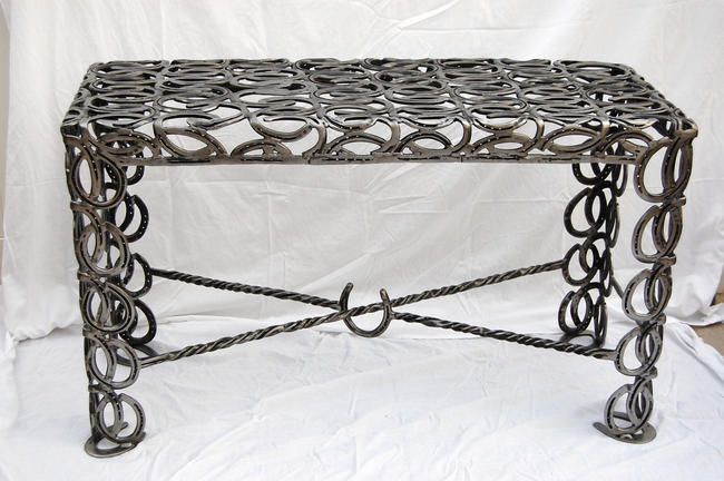 Horseshoe sofa table exudes raw and rustic charm green for Things made from horseshoes