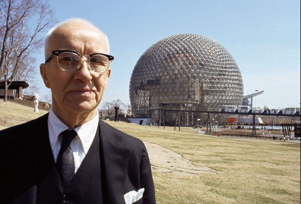 Buckminster FULLER before his geode dome at Montreal World Fair.